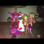 Elf on the Shelf plays Barbies