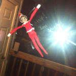 elf on the shelf stuck to window