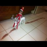 Elf on the Shelf rides reindeer